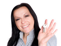 Woman holding keys over white Royalty Free Stock Photography