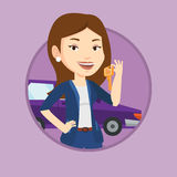 Woman holding keys to her new car. Royalty Free Stock Photo