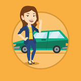 Woman holding keys to her new car. Royalty Free Stock Image