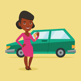 Woman holding keys to her new car. Royalty Free Stock Images