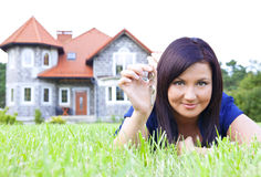 Woman holding keys to house Stock Photo