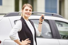 Woman holding keys to new car auto and smiling at camera stock photos