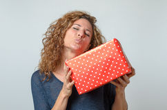 Woman Holding and Kissing Red Gift Box Stock Photo
