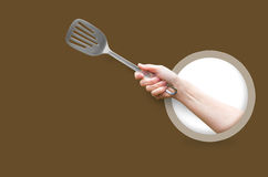 Woman holding a kitchen spatula. Royalty Free Stock Photos