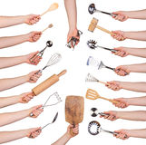 Woman holding kitchen utensils Royalty Free Stock Image