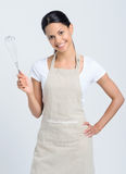 Woman holding kitchen whisk Stock Photography