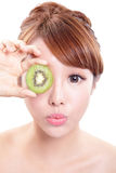 Woman holding kiwi fruit cover her eyes Royalty Free Stock Images