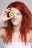 Woman holding kiwi fruit for her eye Royalty Free Stock Image