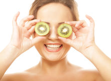 Woman holding kiwi fruit for her eyes. Stock Photography