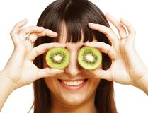 Woman holding kiwi fruit for her eyes. Stock Images