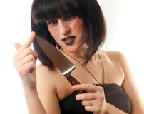 Woman holding a knife Royalty Free Stock Photos