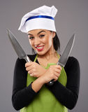 Woman holding knives Royalty Free Stock Photo
