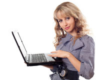 Woman holding laptop Royalty Free Stock Image
