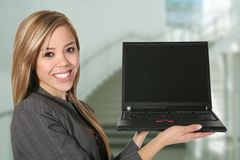 Woman Holding Laptop. A beautiful business woman holding a laptop computer stock images
