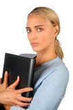 Woman holding laptop. A young woman holding a laptop computer royalty free stock images