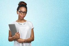 Woman holding laptop. African american woman holding laptop royalty free stock photography