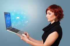 Woman holding laptop with cloud based system concept. Woman holding laptop projecting cloud based system symbols and informations stock illustration