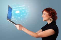Woman holding laptop with cloud based system concept stock photos