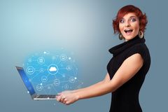 Woman holding laptop with cloud based system concept. Woman holding laptop projecting cloud based system symbols and informations stock image