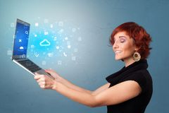 Woman holding laptop with cloud based system notifications. Woman holding laptop projecting notifications, symbols and information based on cloud technology stock illustration