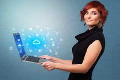Woman holding laptop with cloud based system notifications royalty free stock photos