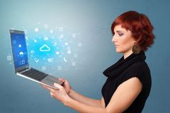 Woman holding laptop with cloud based system notifications royalty free stock photo