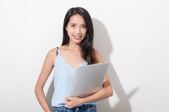 Woman holding laptop computer. Asian young woman portrait Stock Photo