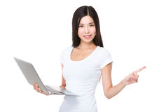 Woman holding a laptop computer and finegr point up Royalty Free Stock Photography