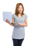 Woman holding laptop computer Royalty Free Stock Photos