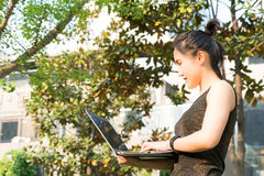 A woman is holding laptop computer to surfing internet Stock Photo