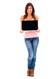 Woman holding a laptop Royalty Free Stock Photography