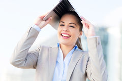 Woman holding laptop over head Stock Photos