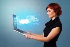 Woman holding laptop with cloud based system notifications. Woman holding laptop projecting notifications, symbols and information based on cloud technology stock images