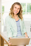 Woman holding a laptop. Smiling woman holding a laptop stock photo