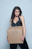 Woman holding large parcel Royalty Free Stock Photo