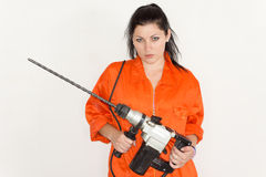 Woman holding a large portable drill Royalty Free Stock Image