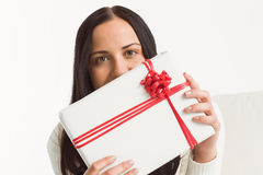 Woman holding a large present Stock Photos
