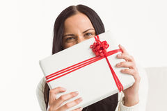 Woman holding a large present Stock Photography
