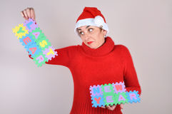 Woman holding a last year and new year sign Stock Photography