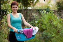 Woman holding laundry basket Royalty Free Stock Image