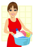 Woman holding a laundry basket full of dirty clothes Stock Image