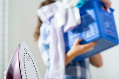 Woman holding the laundry basket Stock Images