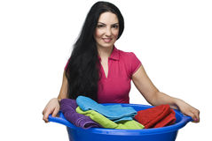 Woman holding  laundry basket with towels Royalty Free Stock Photography
