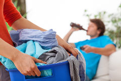 Woman holding laundry Royalty Free Stock Image