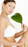 Woman holding a leaf Royalty Free Stock Image