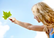 Woman holding a leaf Royalty Free Stock Images