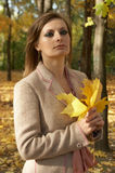 Woman holding leaves. Portrait young woman is holding leaves Stock Photography