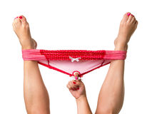 Woman holding legs up with hand in panties Royalty Free Stock Image