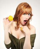 Woman holding a lemon Stock Photo