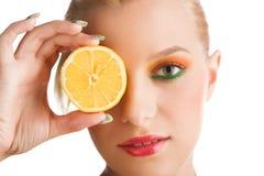 Woman holding lemon Royalty Free Stock Image
